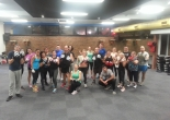 A Boxing Training class poses after another tough, but fun class.