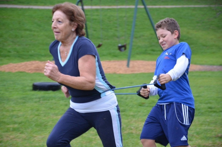 elderly and kids pair up for some fitness training exercises